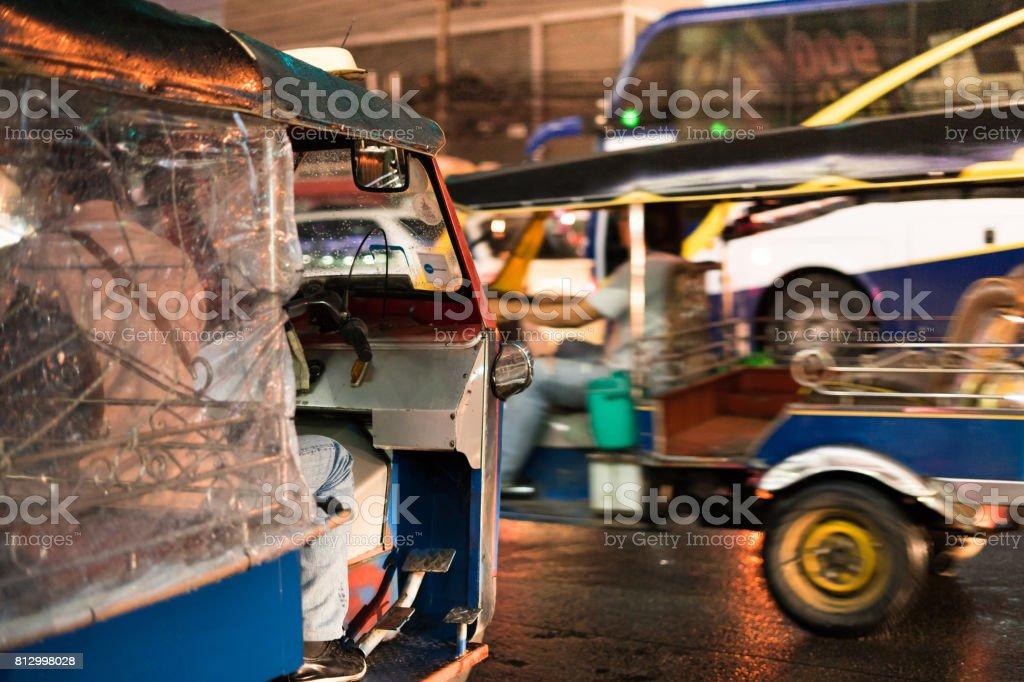 Tuk - tuk on street at night on stock photo