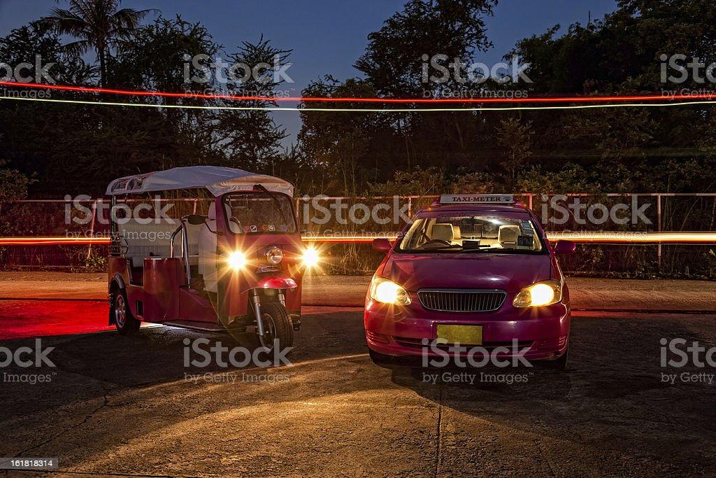 Tuktuk and Bangkok Taxi at night royalty-free stock photo