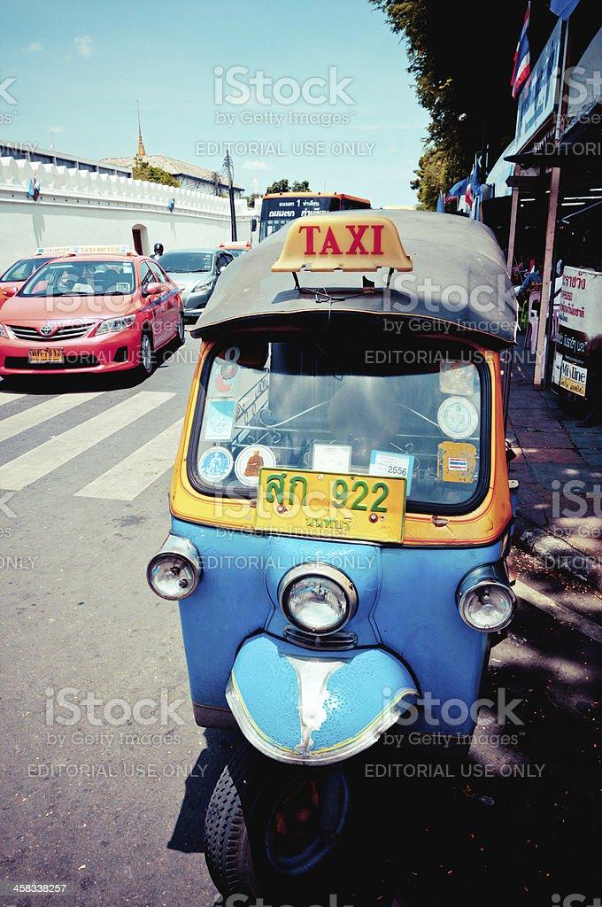 tuk-tuk and taxi on the road in Bangkok royalty-free stock photo