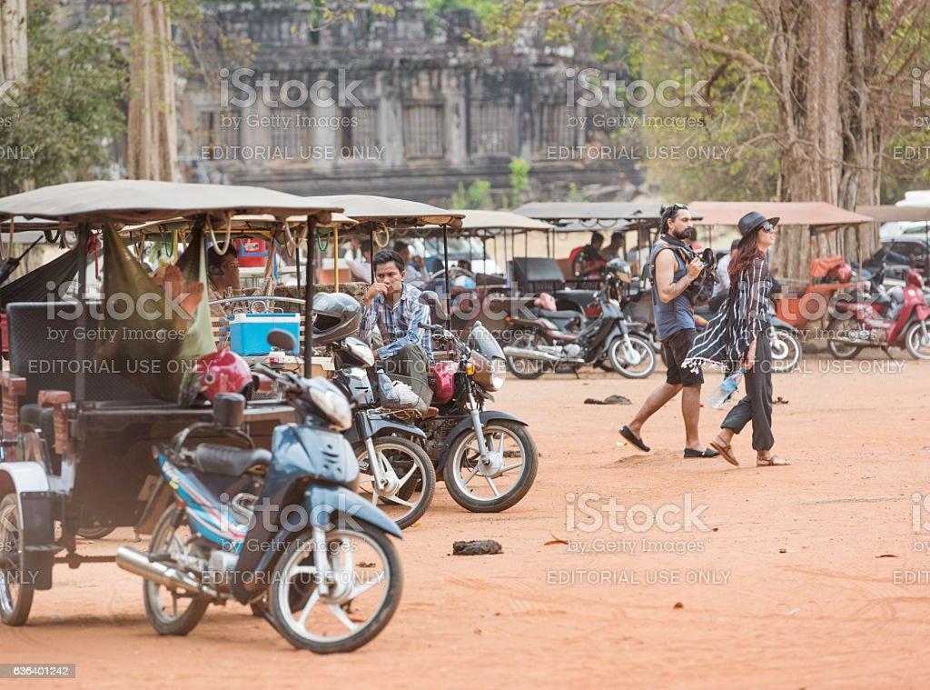 Tuk-Tuk and Tourists by the famous Angkor Wat, Cambodia stock photo
