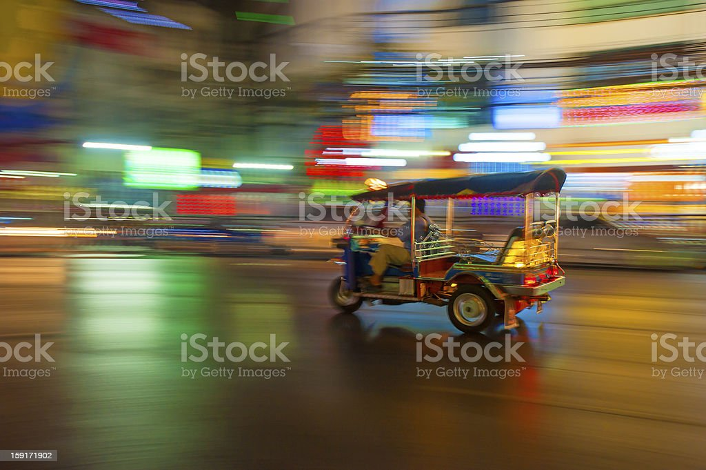 Tuk-tuk in motion blur in Bangkok, Thailand stock photo