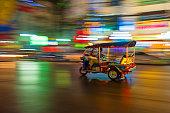 Tuk-tuk in motion blur in Bangkok, Thailand