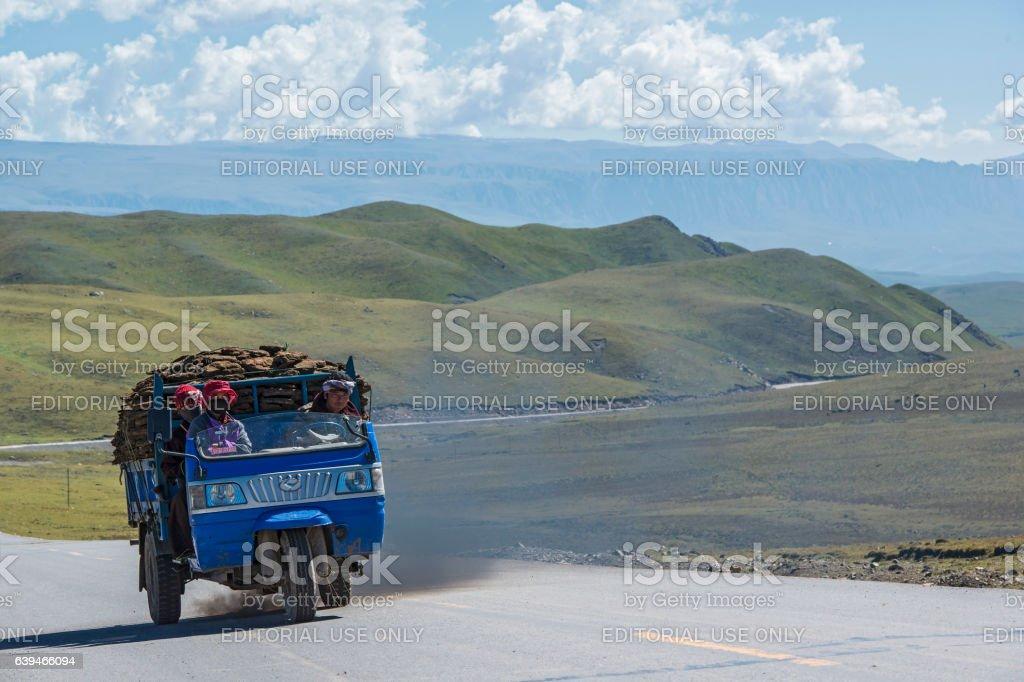 Tuktuk (Jinrikisha) is transporting dried Yak dung, Tibet stock photo