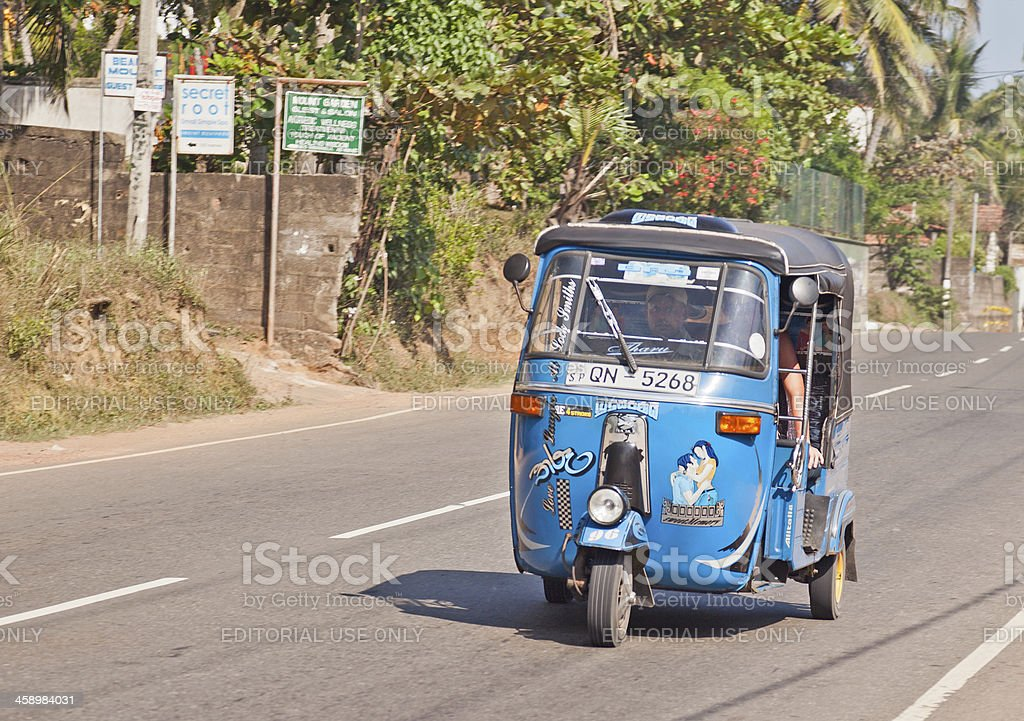 Tuktuk on CGHW Highway, Mirissa, Sri Lanka royalty-free stock photo