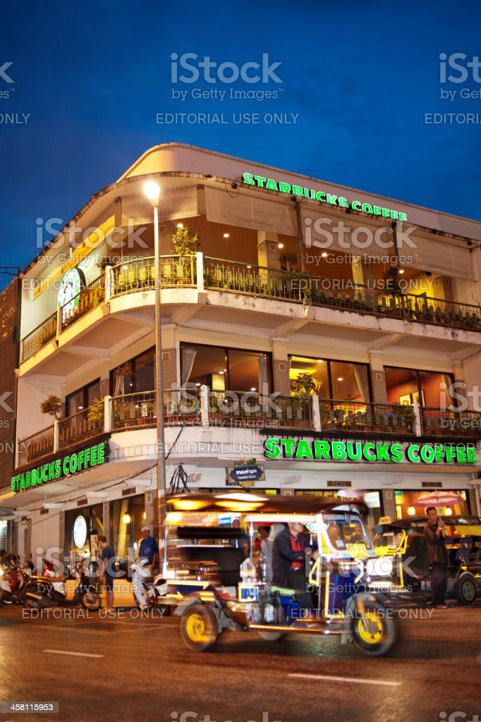 Tuktuk passes Starbucks in Chiang Mai, Thailand royalty-free stock photo