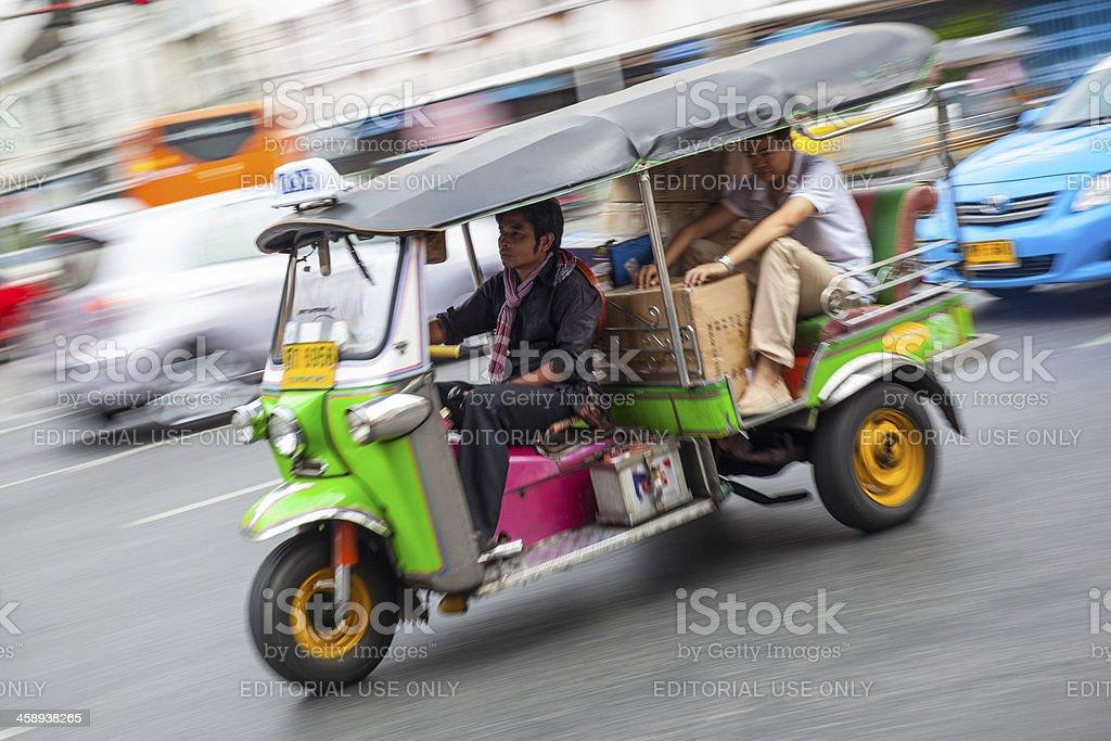 Tuk-Tuk Speeding in Bangkok City Street Panning royalty-free stock photo