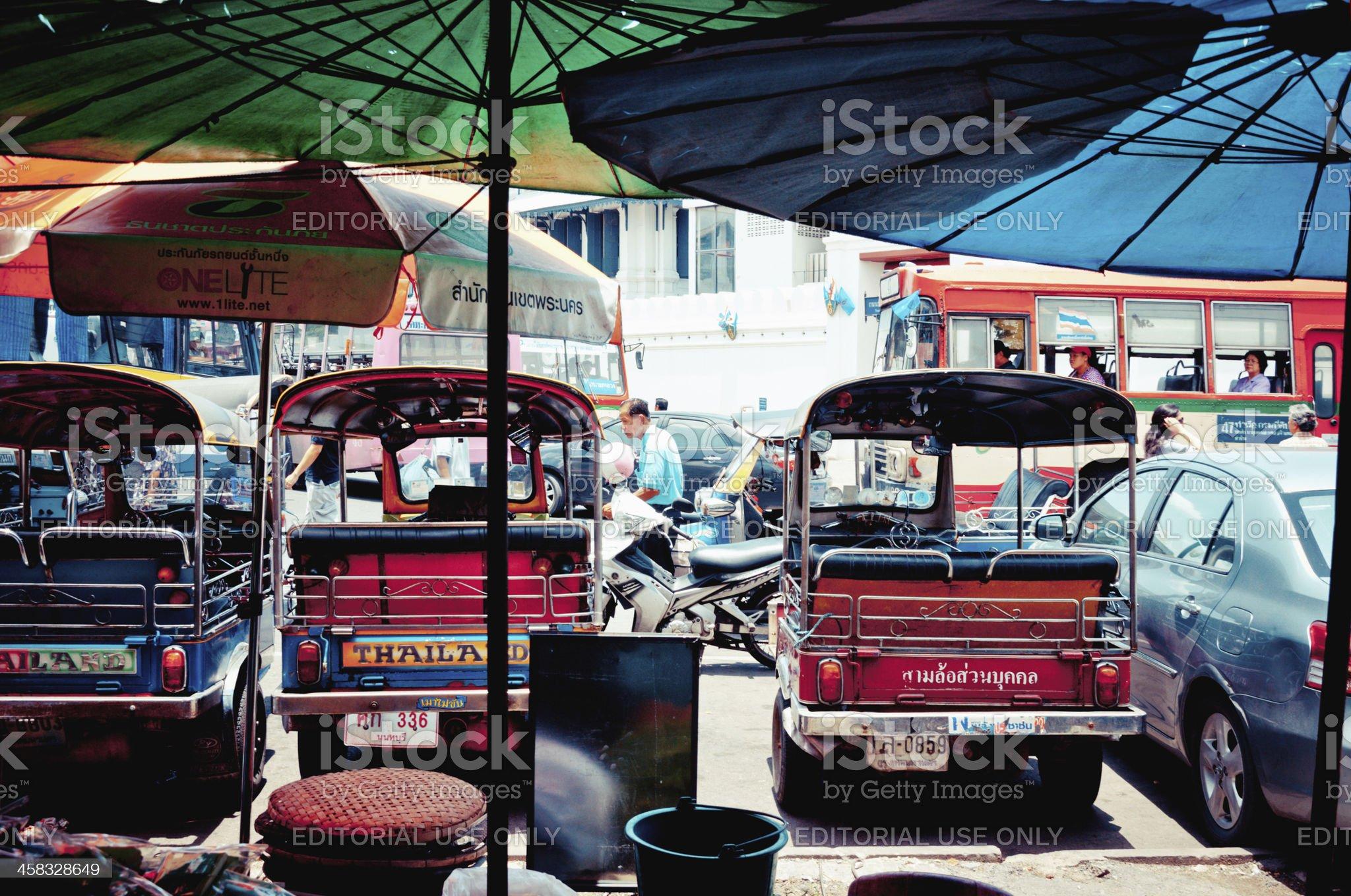 tuk-tuk taxis and traffic on the road in Bangkok royalty-free stock photo