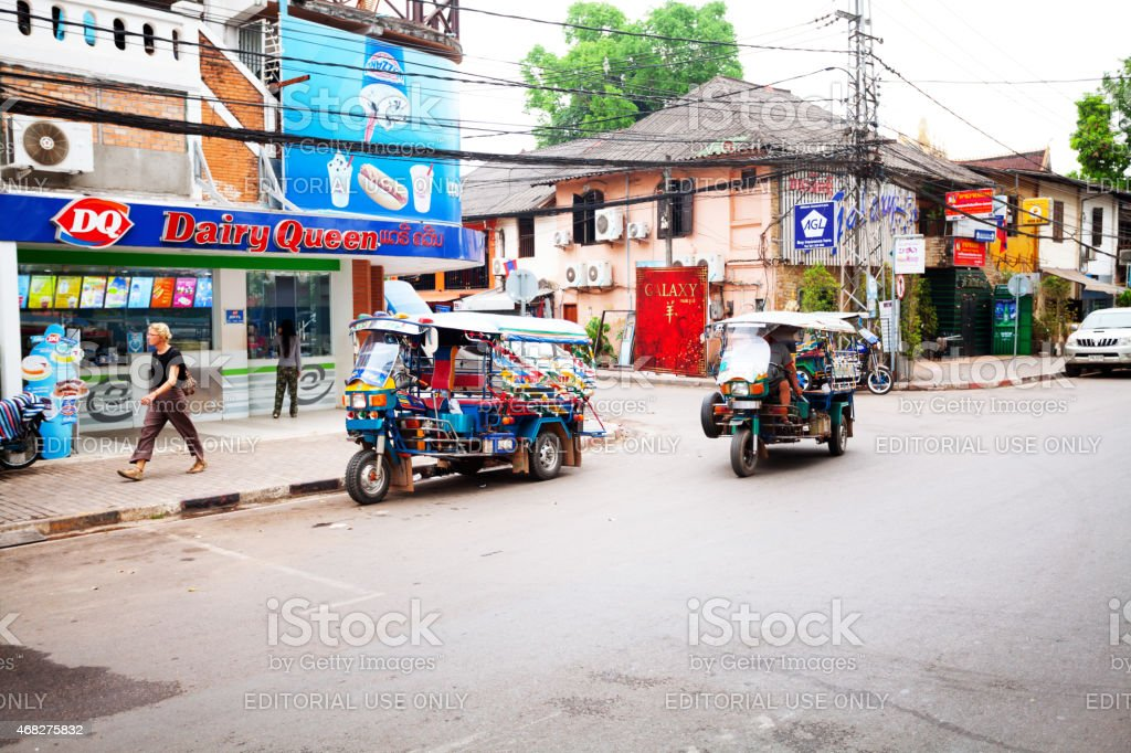 Tuktuks in street Quai Fa Ngum stock photo