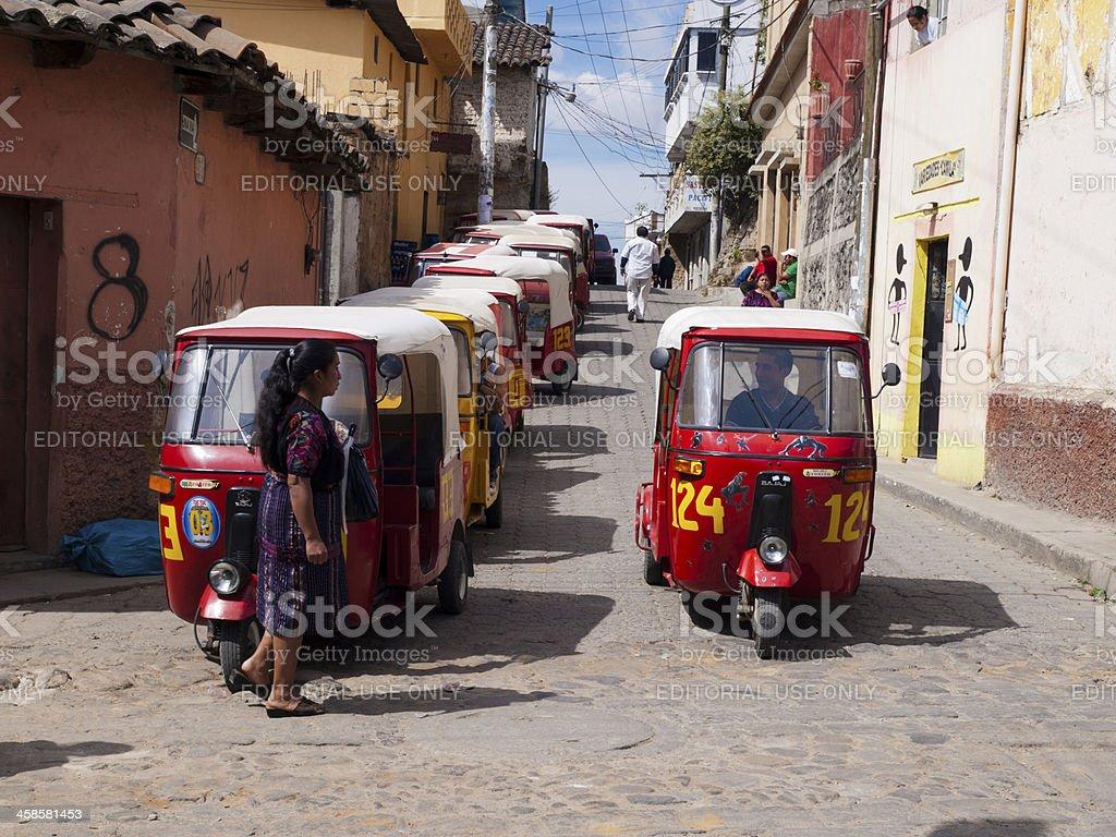 Tuk-Tuks wait for passengers, Chichicastenango, Guatemala royalty-free stock photo