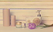 tulip, cosmetics and candles lying on the table
