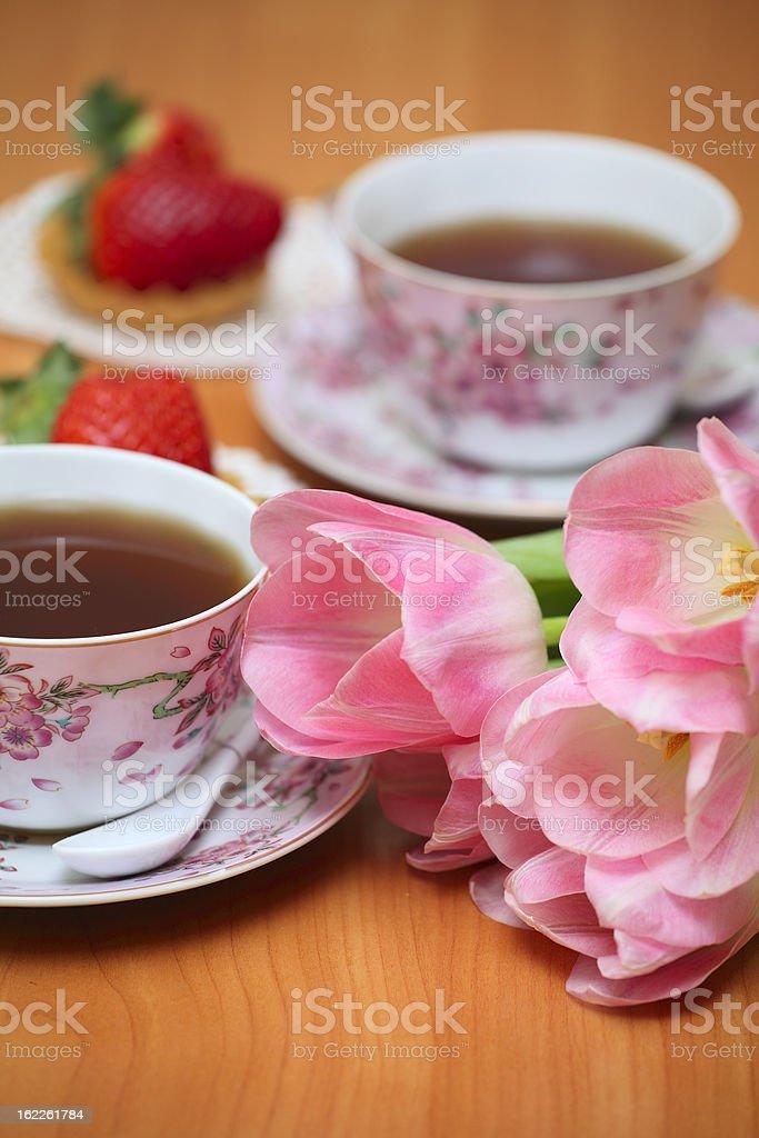 Tulips and tea royalty-free stock photo