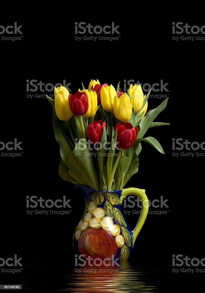 Tulips in Pitcher reflections royalty-free stock photo