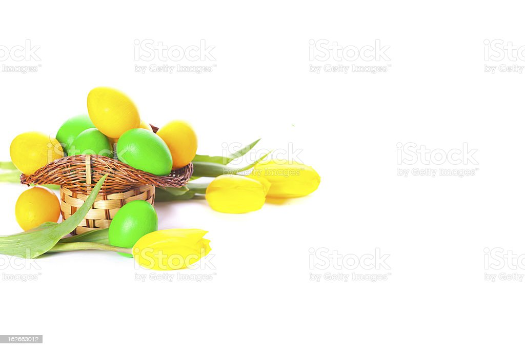 tulips with painted easter eggs in basket isolated on white royalty-free stock photo