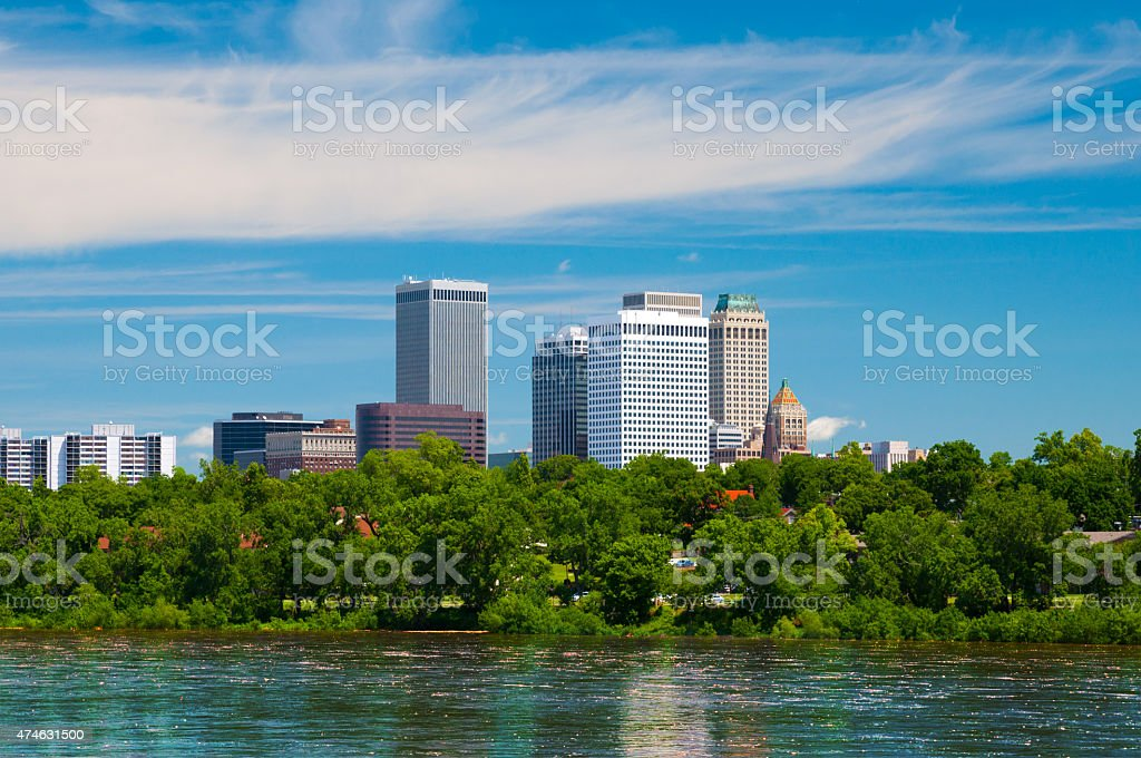 Tulsa downtown skyline, trees, and river stock photo