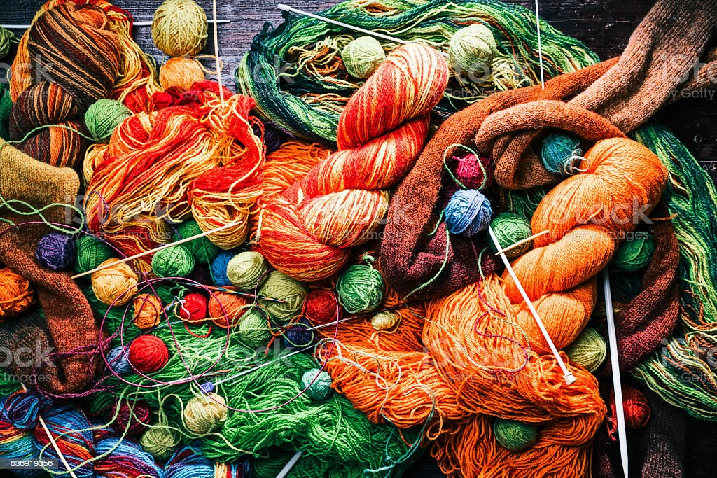 Tumbled knitting workshop stock photo