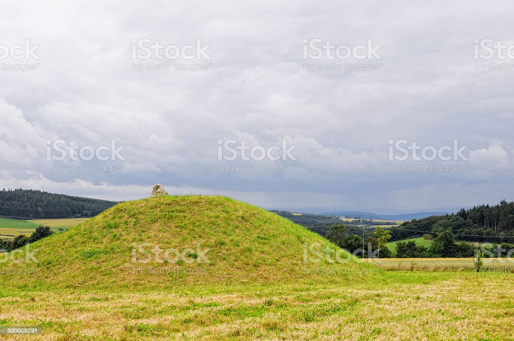 Tumulus grave stock photo