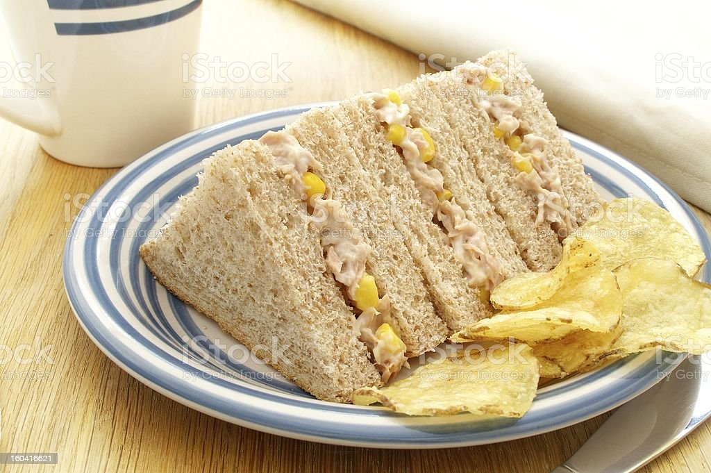 tuna & sweetcorn sandwiches with potato chips royalty-free stock photo