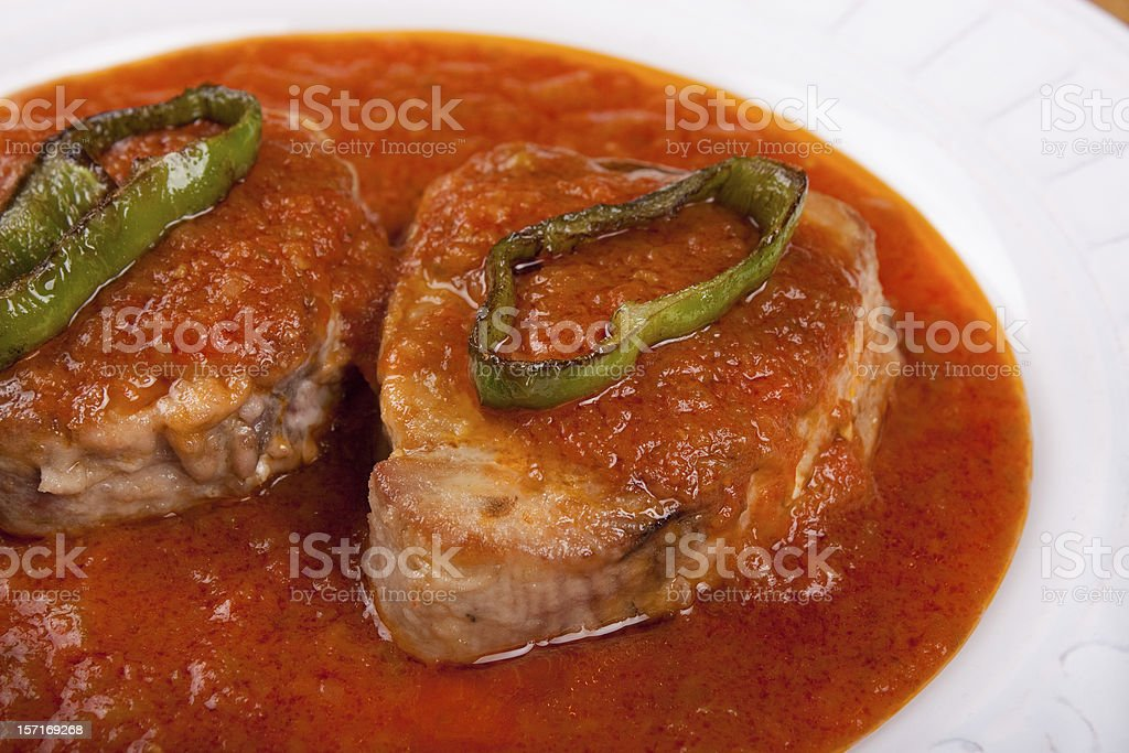 Tuna fish in tomato sauce with slices of fried pepper royalty-free stock photo