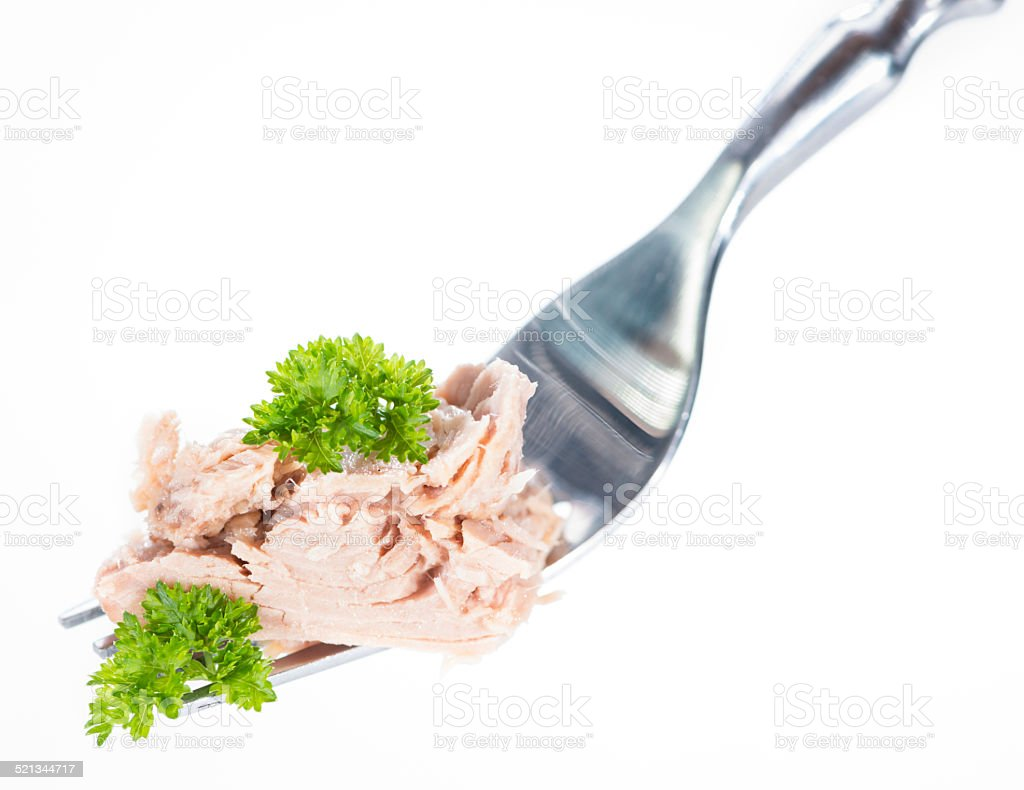 Tuna on a fork (over white) stock photo