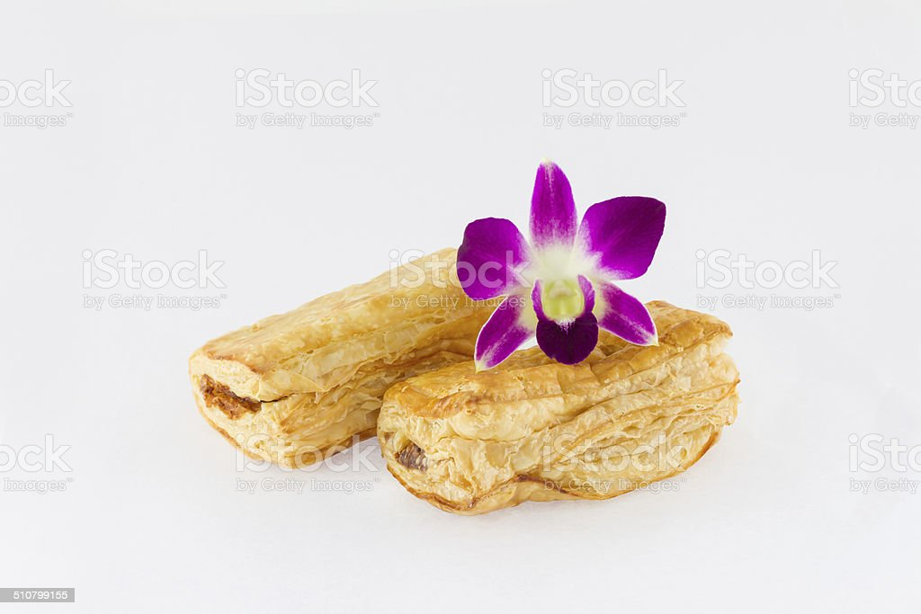 Tuna puff  and purple orchid on white background stock photo