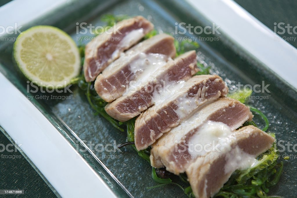 Tuna steak on wakame. royalty-free stock photo