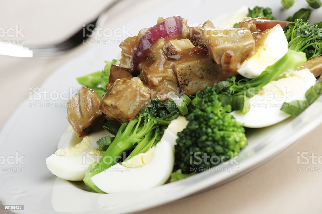 Tuna steak under gravy royalty-free stock photo