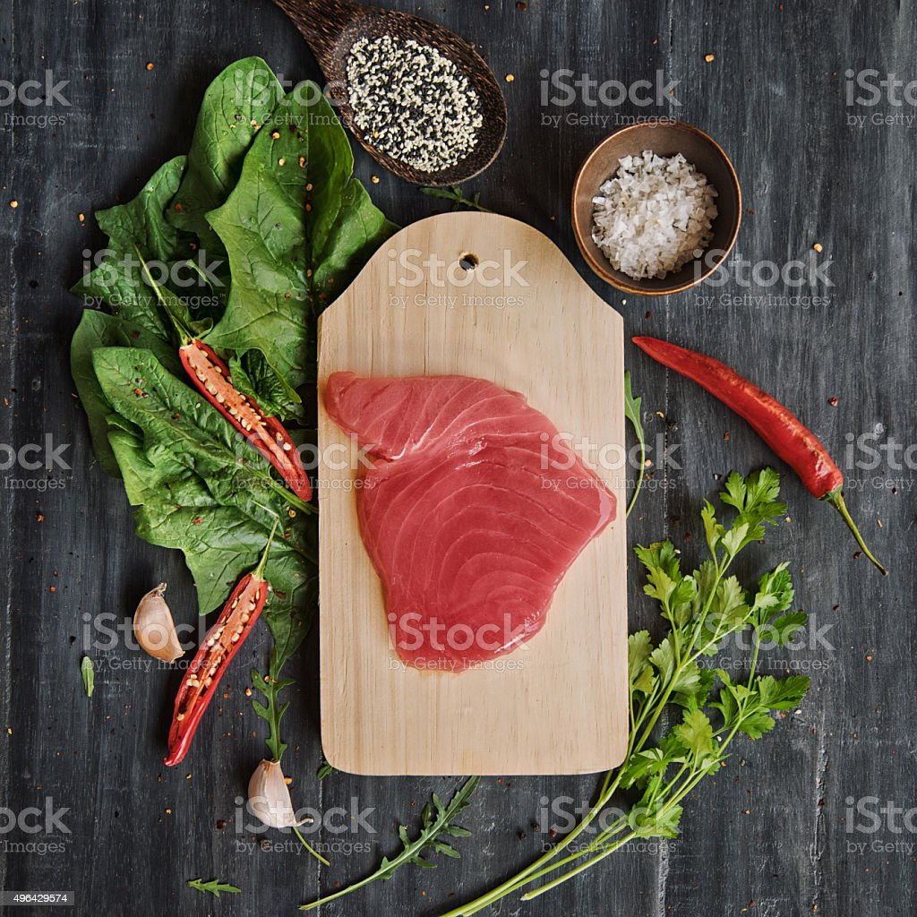 Tuna steak with greens and spices stock photo