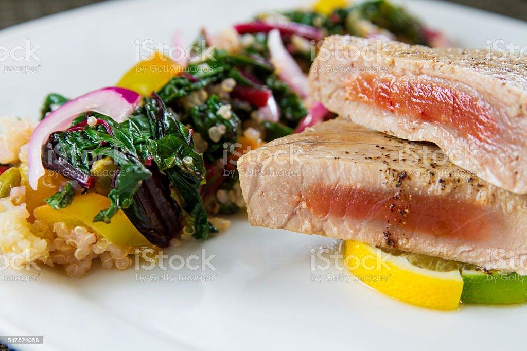 Tuna steak with salad and lemon stock photo