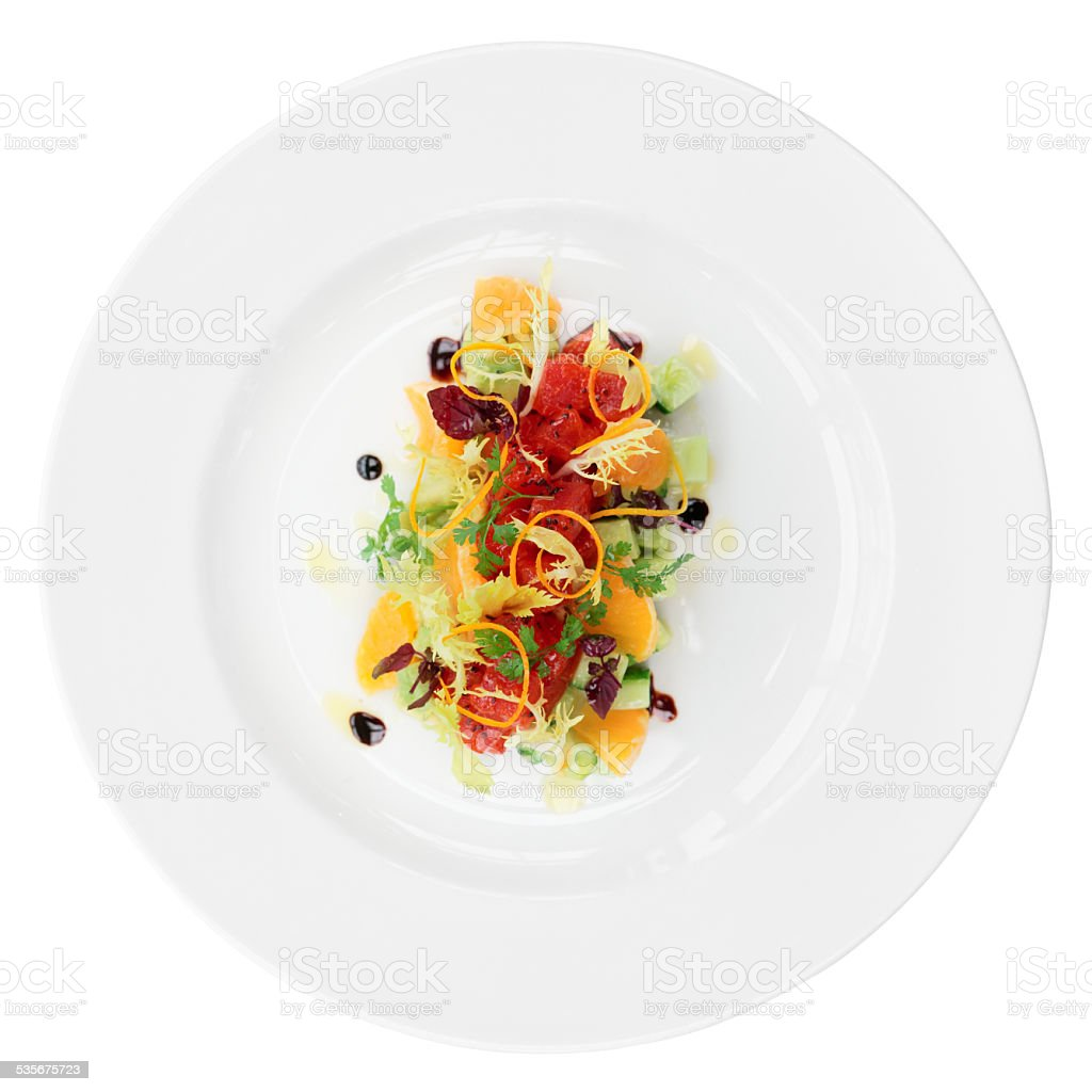 Tuna tartar with cucumber and orange, isolated stock photo