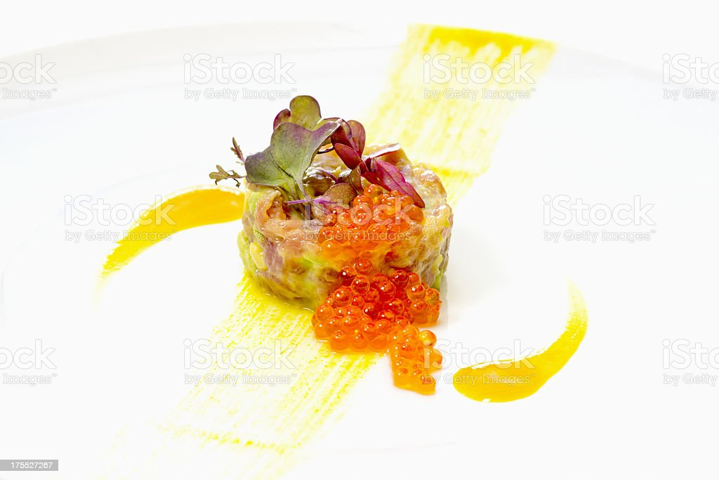 Tuna tartare with trout eggs royalty-free stock photo