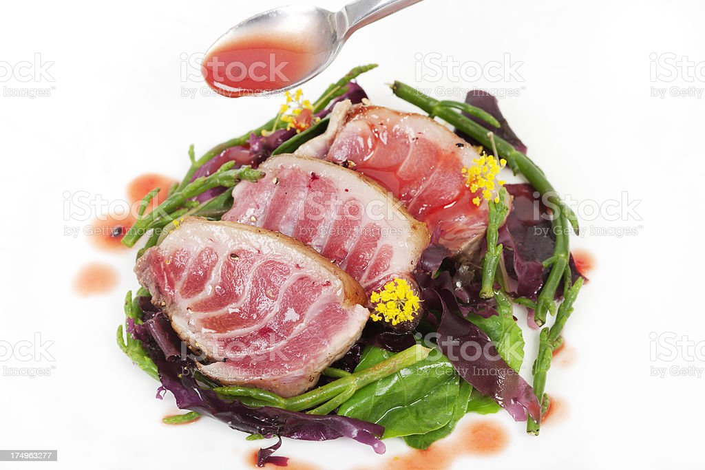 Tuna with sauce and sea vegetables royalty-free stock photo
