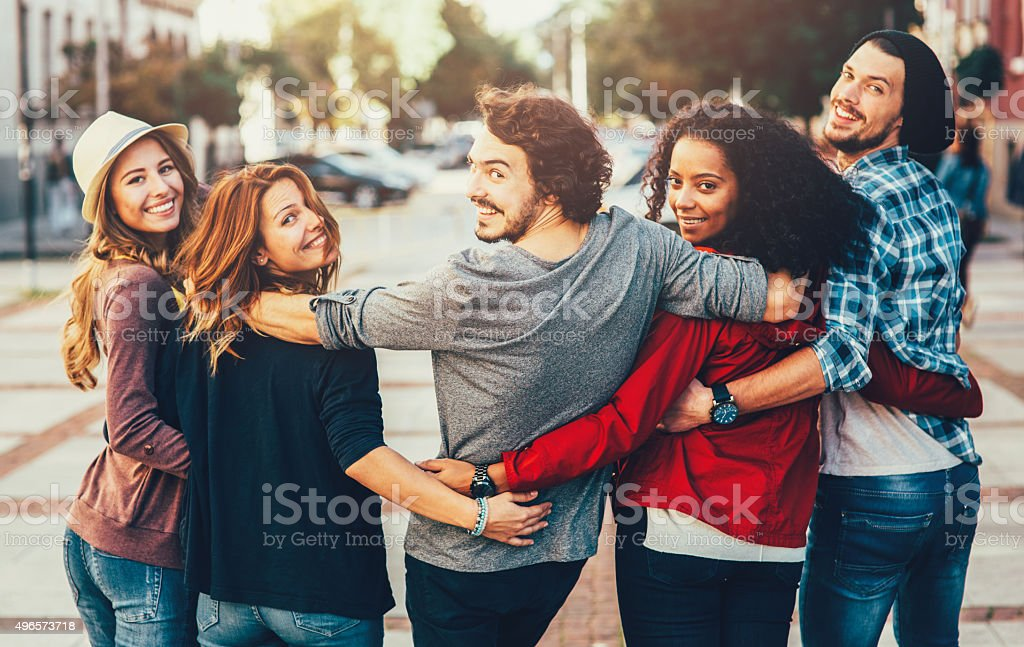 Tuned Back Friend Hug stock photo