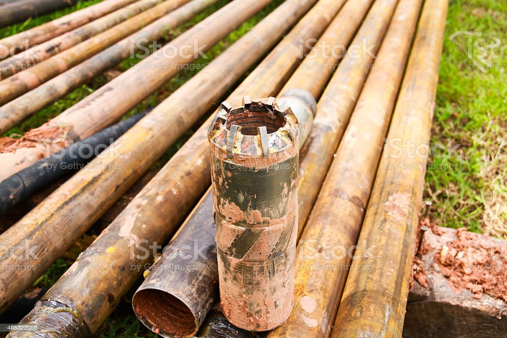 Tungsten core bit and drilling pipe used in the mining stock photo