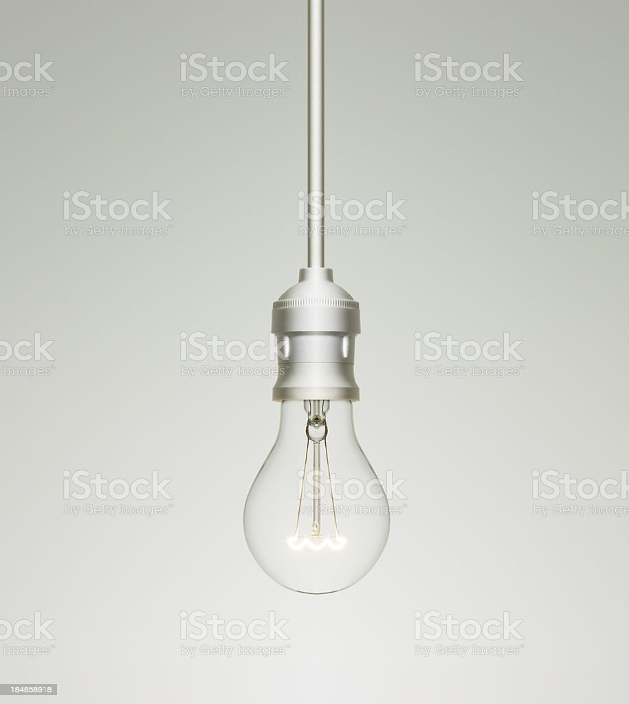 Tungsten light bulb turned on royalty-free stock photo