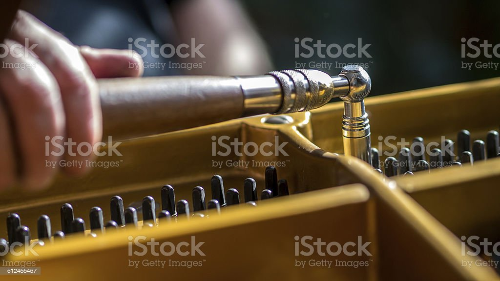Tuning a grand piano stock photo