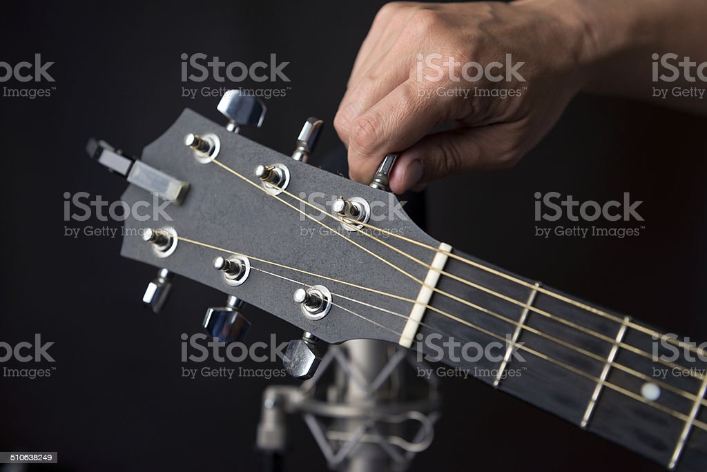 Tuning a Guitar stock photo