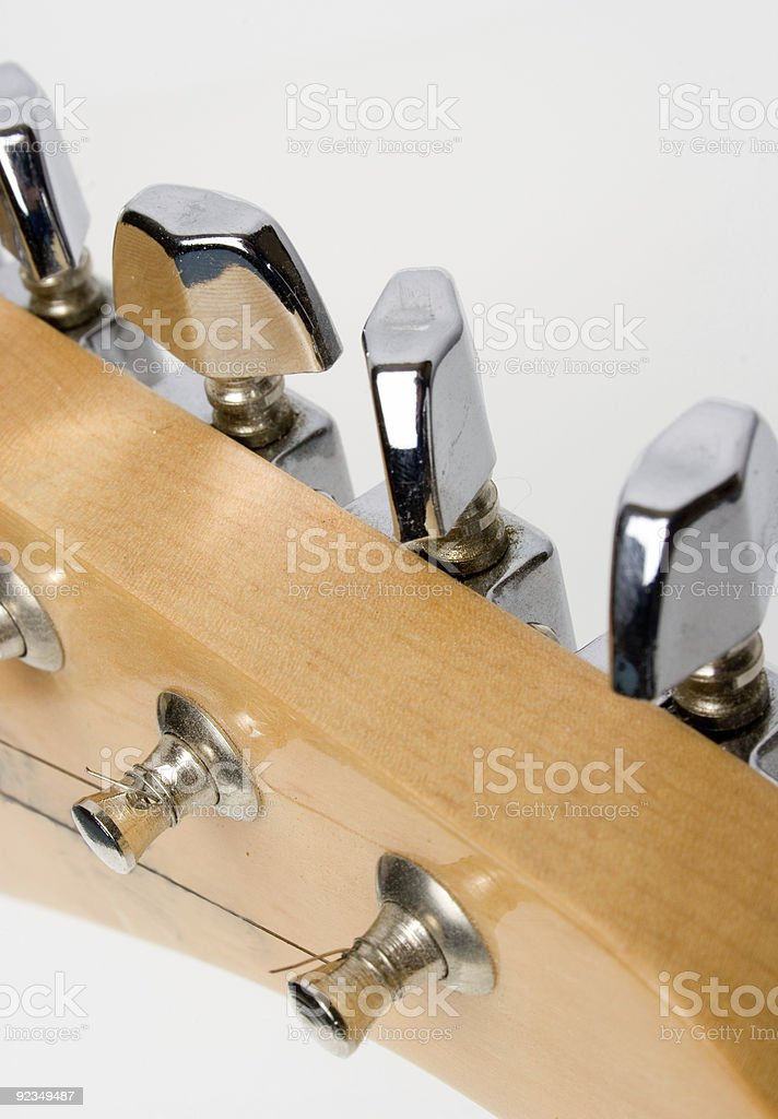 tuning guitar royalty-free stock photo