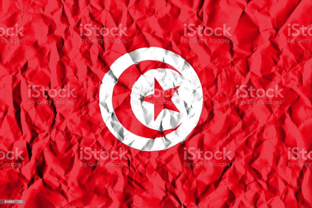Tunisia Crisis Concept: Crumpled Paper Tunisian Flag stock photo