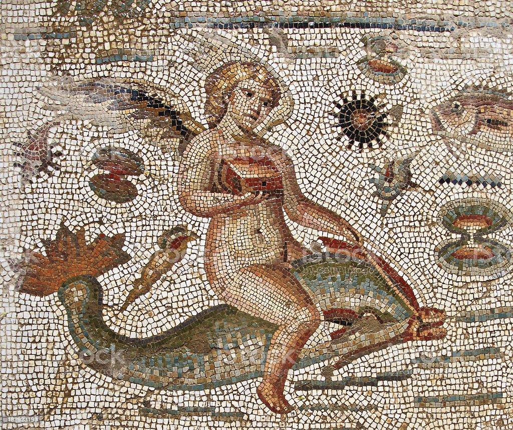 Tunisia: Roman Era Mosaic of Angel Riding DOlphin, Bulla Regia royalty-free stock photo