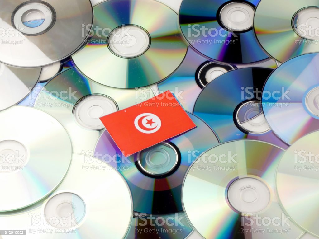 Tunisian flag on top of CD and DVD pile isolated on white stock photo