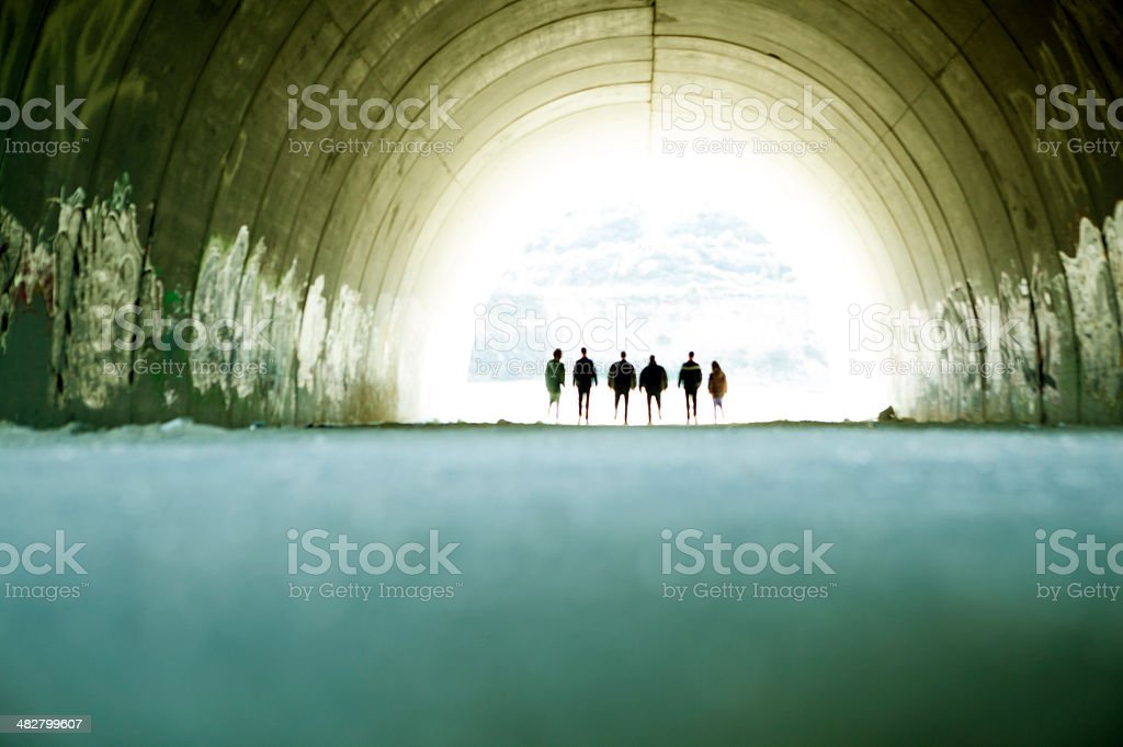 Tunnel and people silhouettes stock photo