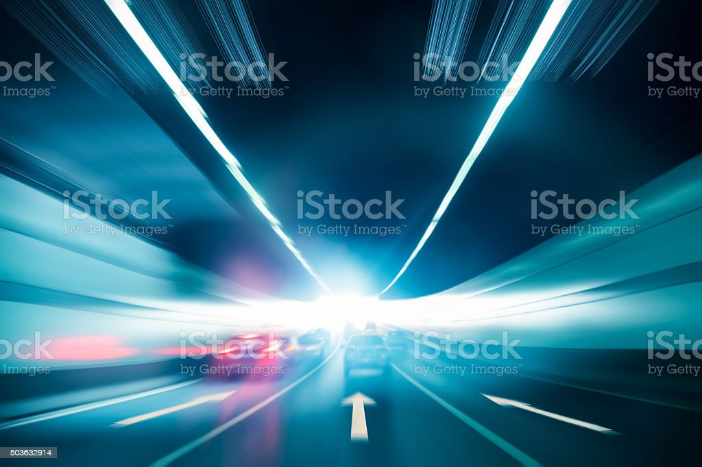 tunnel background with exit light stock photo
