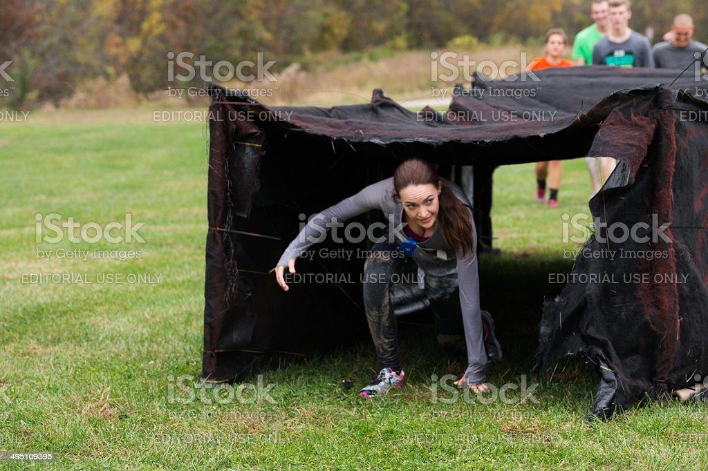 Tunnel crawl on Zombie Run stock photo