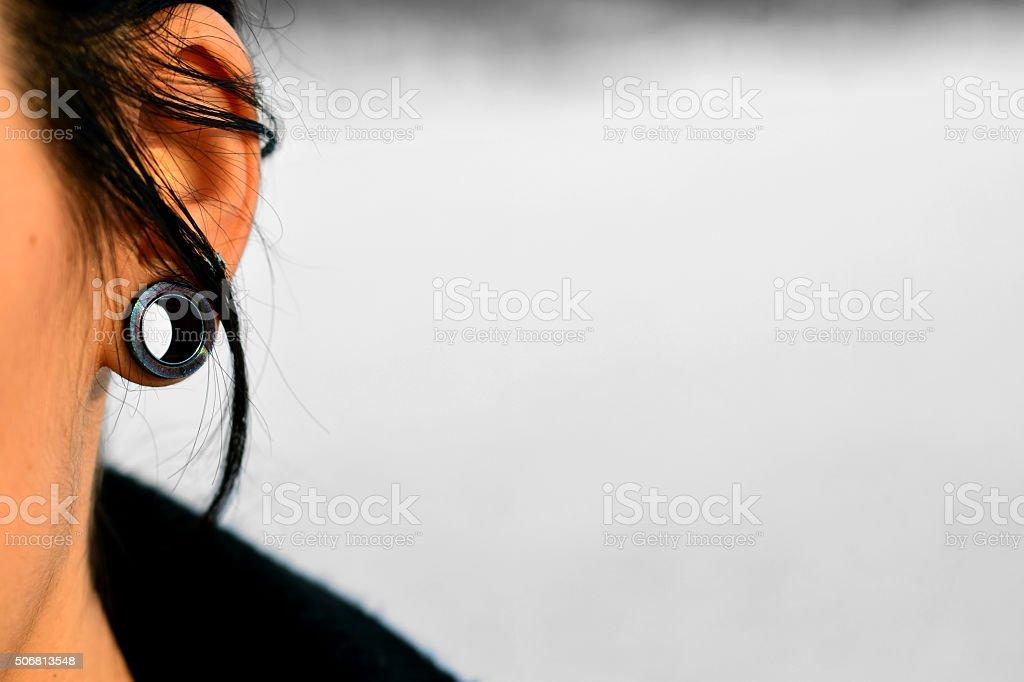 Tunnel ear (Piercing) stock photo