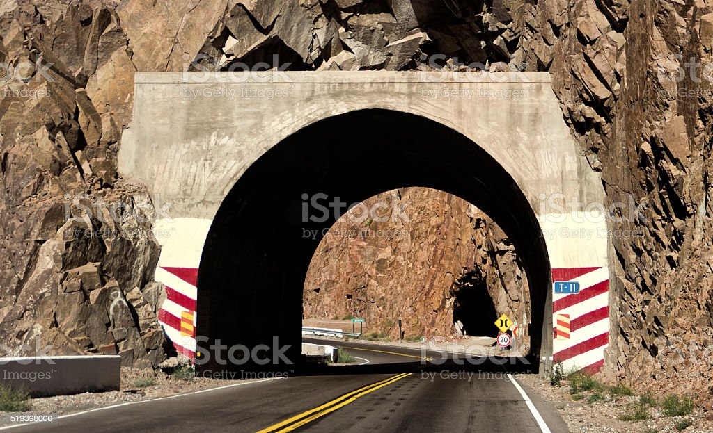 Tunnel in mountain road stock photo