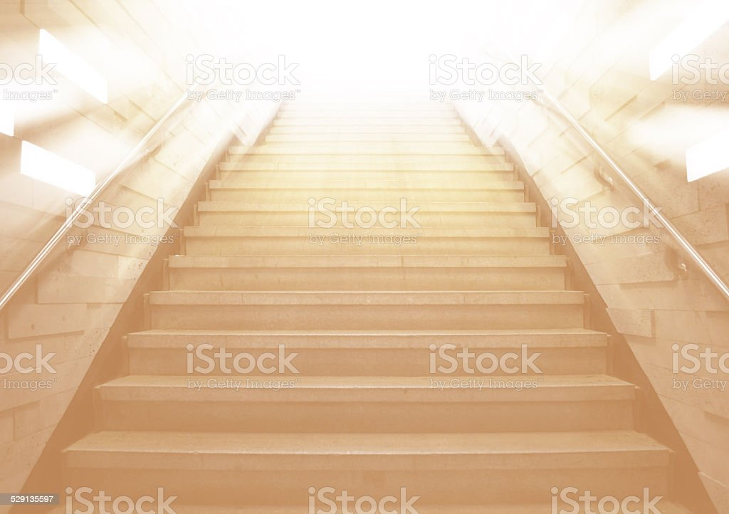 tunnel Staircase going up to the light stock photo