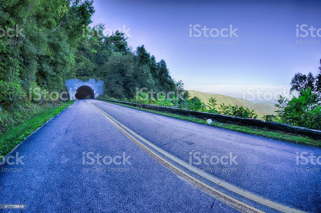 tunnel through mountains on blue ridge parkway in the morning stock photo