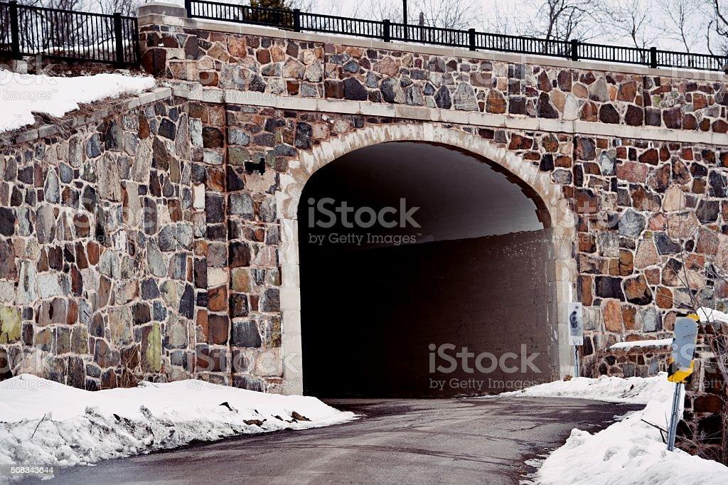 Tunnel under stone bridge royalty-free stock photo