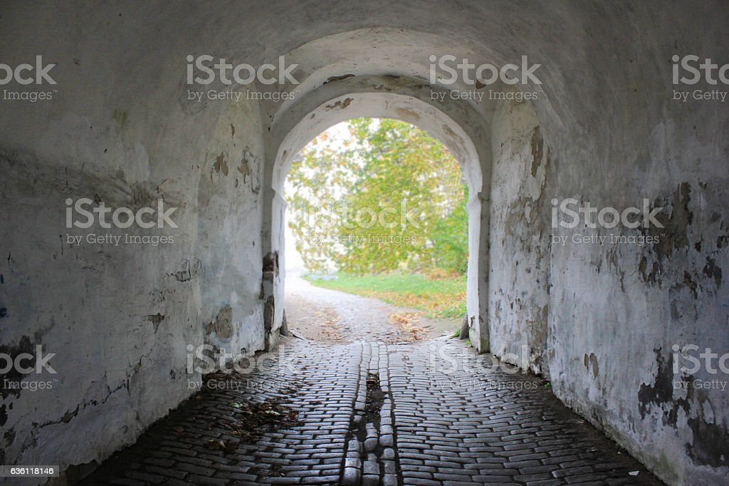 Tunnel vision perspective historic arch with rustic old white walls stock photo