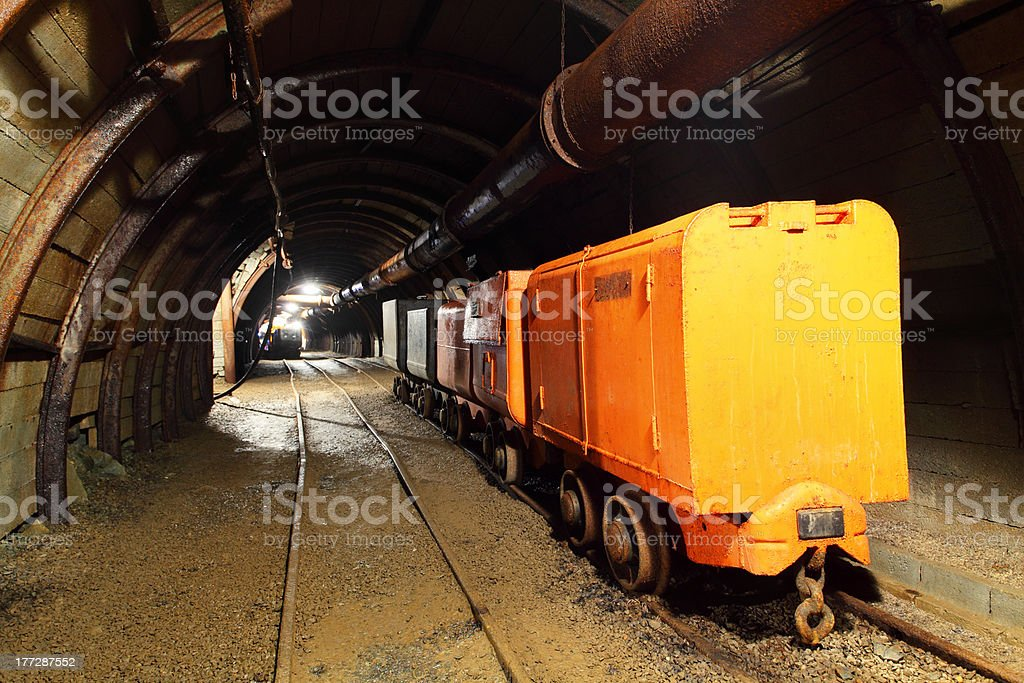 Tunnel with mining train in gold silver and copper mine royalty-free stock photo